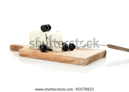 blue cheese and black olives on cheeseboard