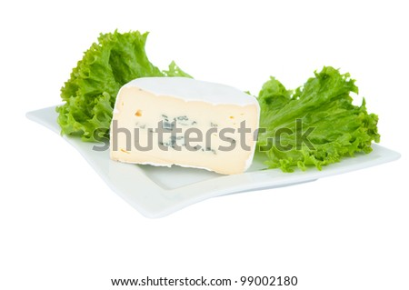 blue cheese with lettuce on a plate on a white background