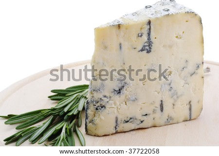 Blue cheese with rosemary on catting board