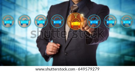 Blue chip automobile designer selecting a connected auto in a lineup. Concept for autonomous or driverless car, vehicle tracking system, artificial intelligence and vehicular communication systems. #649579279