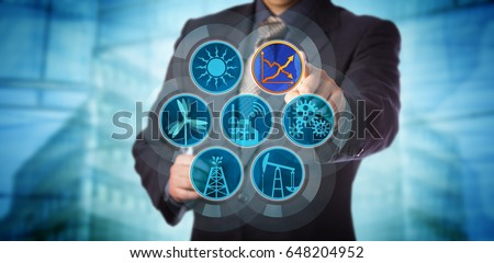 Blue chip manager monitoring energy efficiency via a virtual control interface. Industry concept for efficient energy use, sustainability reporting, audit and rise in renewable power generation. #648204952