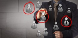 Blue chip marketing manager is circling three candidates in a group of male and female white collar icons. Business concept for target audience, market segmentation, sales prospecting and recruiting.