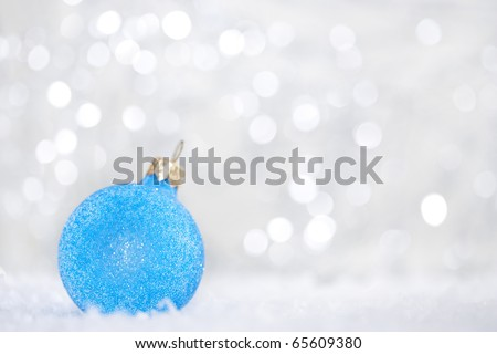 Blue christmas ball on abstract light background.