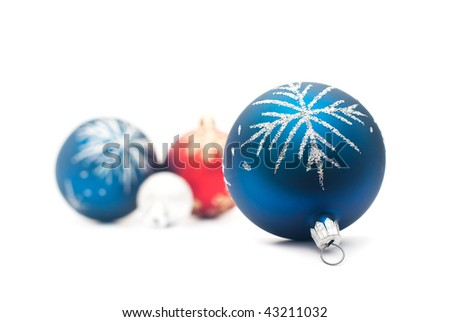 Blue christmas ball on the foreground and group of the blured balls