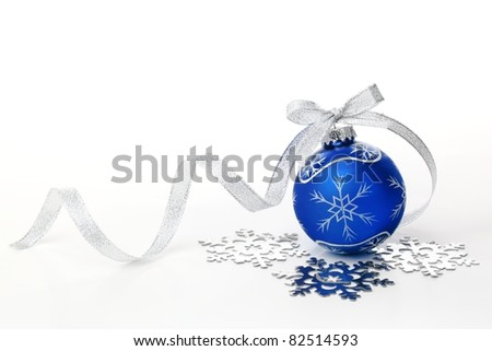 Blue christmas ball with silver ribbon bow and snowflake on white background.
