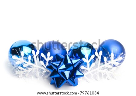 blue christmas balls in a row with ribbon and ornamental snowflake on white background