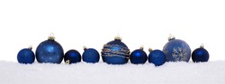 Blue christmas balls isolated on snow, Christmas decoration