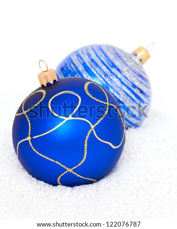 Blue Christmas Balls lying on snow