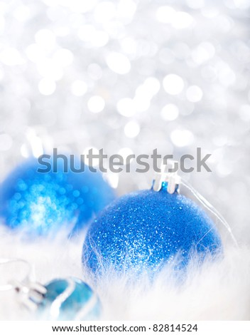 Blue christmas balls on abstract background