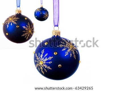 Blue Christmas balls over white background - isolated