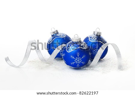 Blue christmas balls with ribbon on white background.