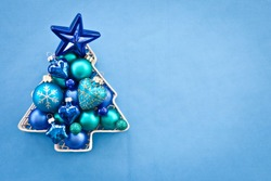 Blue christmas baubles arranged in a tree shape