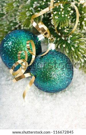 blue christmas baubles with christmas tree branch in snow decoration