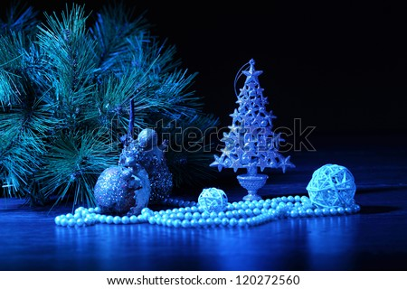 Blue Christmas collage. Ball and ribbon on a blue background.