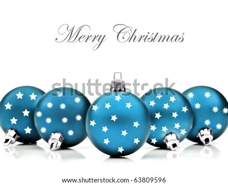 Blue christmas decoration baubles on a white background with space for text