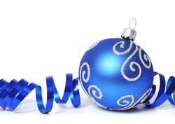Blue christmas decoration with a ribbon isolated on white