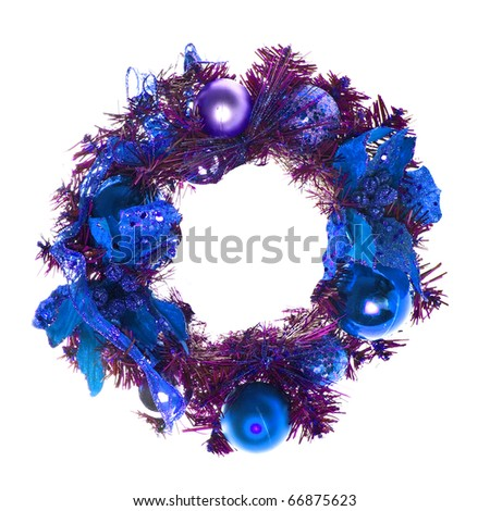 Blue christmas garland with baubles and ribbons on white.