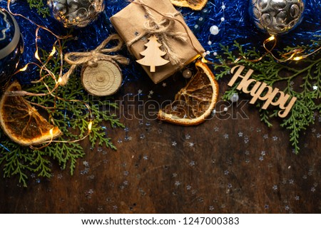 Blue christmas. gift in craft wrapping paper, ribbon, christmas balls. presents on dark wooden table  #1247000383