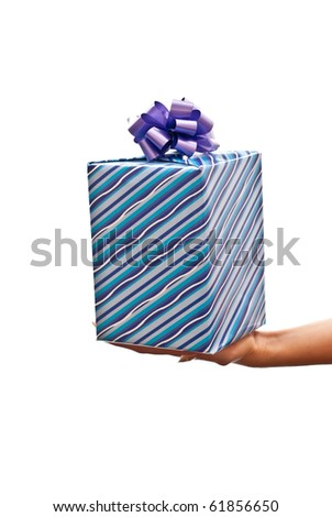 Blue christmas present on the hand. Isolated on white