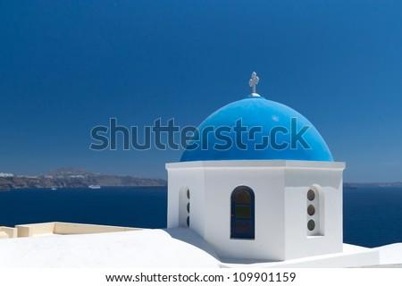 Blue church of Oia village at Santorini island. Greece