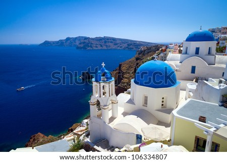 Blue churches of Oia village at Santorini island. Greece - stock photo