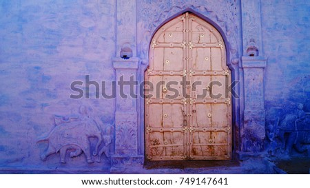 Blue city, Jodhpur, Rajasthan, India. Blue houses, background. Bright blue streets and walls. Popular tourist city in India. Old vintage wood carved door. Pattern wall. #749147641