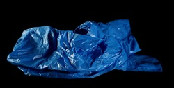 Blue clean, crumpled plastic garbage bag isolated on black background