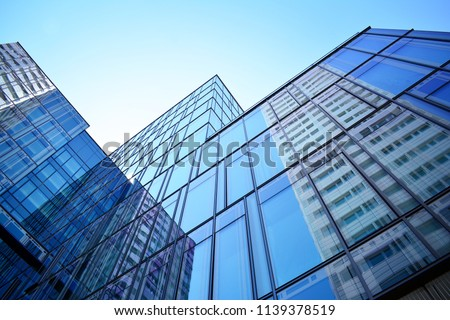 Blue clean glass wall of modern office building #1139378519