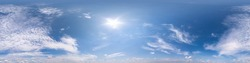 blue clear sky with beautiful fluffy clouds without ground. Seamless hdri panorama 360 degrees angle view without ground for use in 3d graphics or game development as sky dome or edit drone shot