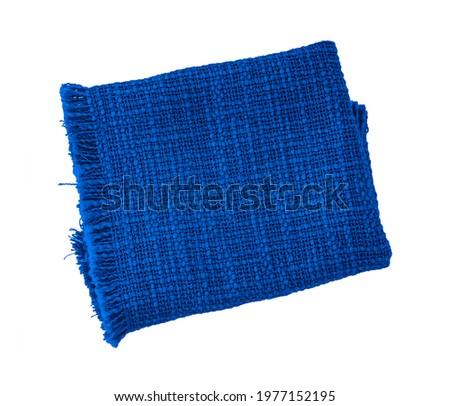 Blue cloth napkin isolated on white background. fiber towel or tablecloth. Cotton. Dishtowel. Kitchen. Serviette. Dishcloth. Textile. Stock photo ©