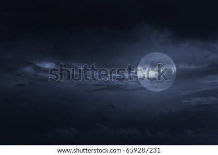 Stock Photo Blue cloudy full moon night sky