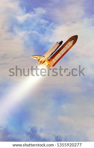Blue cloudy sky and rocket. Launching space ship into cosmos. Elements of this image furnished by NASA. #1355920277