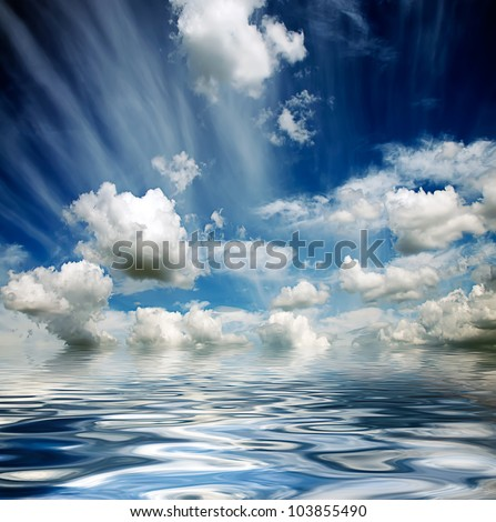 blue cloudy stormy sky reflected in water waves