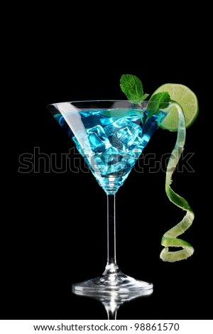 Blue cocktail in glass on black background