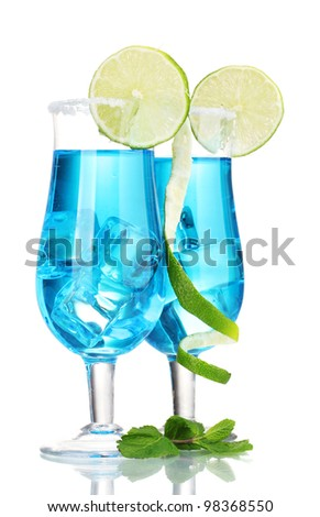 Blue cocktail in glasses with ice and sugar isolated on white