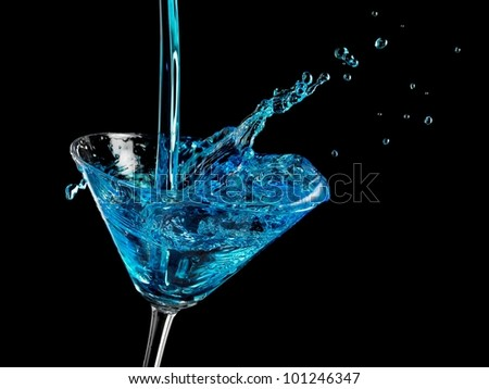 Blue cocktail splash in martini glass