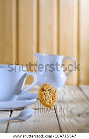 blue coffee cup and jug on white table