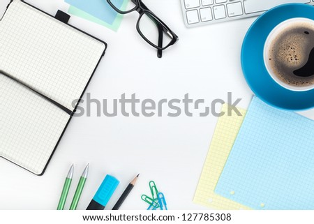 Blue coffee cup and office supplies. View from above. Closeup on white background