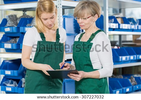 Blue-collar female workers are in the warehouse