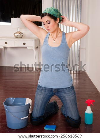 Blue Collar Worker Maid Doing Cleaning Chores Scrubbing Floor