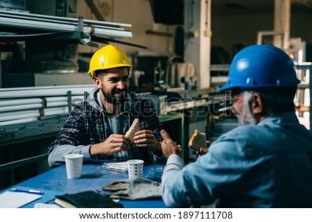 blue collar workers having lunch break Stockfoto ©