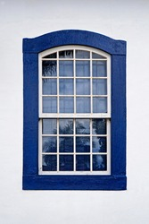 Blue colonial window in Ritapolis, Minas Gerais, Brazil