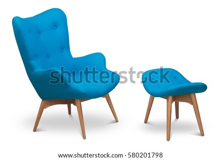 Blue color armchair and small chair for legs. Modern designer armchair on white background. Textile armchair and chair. Series of furniture #580201798