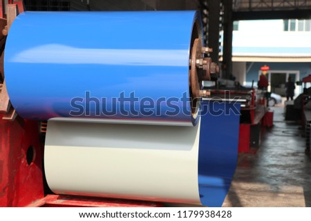 Blue color coated coiled steel in metal sheet rolling machine ; for tile manufacturing ; metal sheet coated steel that made from hot-dip ; industrial equipment background #1179938428