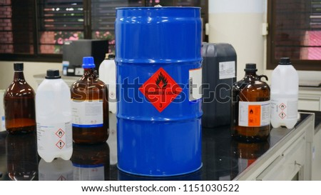 Blue color hazardous dangerous chemical drum barrels with red flammable liquid warning label and  Variety type of flammable liquid container