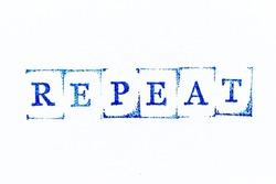 Blue color ink rubber stamp in word repeat on white paper background