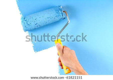 blue color painting wall with roller - stock photo