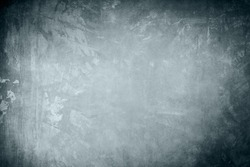 Blue colored grungy backdrop or texture