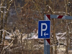 Blue colored parking sign with white