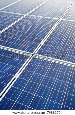 blue colored, photovoltaic solar modules for producing electricity, green energy concept texture
